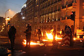 Athens, Greece. 15th July, 2015. Anti-bailout protesters clash with riot police in Athens, Greece, July 15, 2015. Anti-austerity protests organized by trade unions and opposition parties on Wednesday evening in front of the Greek parliament have been marred with violent clashes which broke out between protestors and anti-riot police. © Marios Lolos/Xinhua/Alamy Live News - Stock Image - EXN79N
