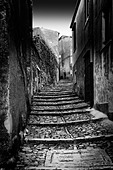Narrow cobblestone stairs illuminated by moonlight - Stock Image - D132D2
