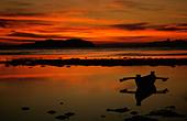 KOTA KINABALU  MALAYSIA , SUNSET ON SEA WITH CANOE - Stock Image - BCEFW6