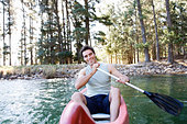 A young man in a canoe - Stock Image - A7HB5M