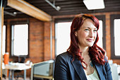 Female entrepreneur in creative office space - Stock Image - DA4T2A