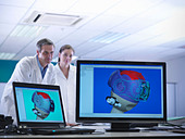 Scientists look at CAD drawings - Stock Image - C407MR