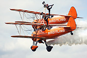 Breitling Wingwalkers British aerobatics and wingwalking team performing at Farnborough Airshow 2012, UK - Stock Image - D58437