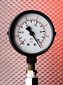 a pressure gauge showing high pressure - Stock Image - AGGX41