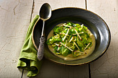 Sautéed Brussel Sprouts leaves with Apple-Mustrad sauce. - Stock Image - BWWD2F