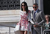 epa04421642 Newlywed couple, US actor George Clooney (R) and his wife Amal Alamuddin (C) get on board of a taxi boat, in Venice, Italy, 28 September 2014. Clooney and Alamuddin got married the day before at the Aman Resort hotel.  EPA/ALESSANDRO DI MEO - Stock Image - E86B20