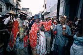 Men dancing and playing music in costume in the Santiago Carnival in Cuba - Stock Image - A32MDA