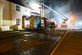 Codford St Mary Wiltshire 25th October 2014 70 Fireman from across Wiltshire and Avon & Somerset with 10 fire appliances tackle a thatched cottage roof fire saving the neighboring property © Paul Chambers/Alamy Live News - Stock Image - E9DAD9