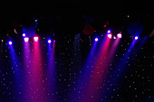 Colorful Stage Lights at a Theater with Copy Space - Stock Image - AJWPXG