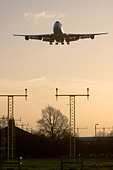 Large commercial airliner approaching London Heathrow Airport, England, UK. - Stock Image - BEGR1G