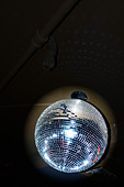 Mirror Ball aka Disco Ball Against a Black Background with Copy Space - Stock Image - AJXM9R