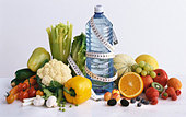 Vegetables, fruit, water & tape measuring (symbolising diet) - Stock Image - AF6DHT