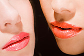 Close-up of two young women with red lips - Stock Image - BH97AC