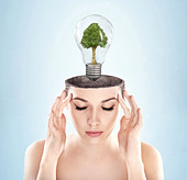 Open minded woman with green energy symbol - Stock Image - C5JG5K