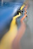 Electric cords on stadium floor - Stock Image - CNT9CY