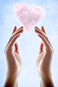 Hands with pink heart shaped cloud floating above them - Stock Image - D53FN9