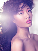 Beautiful asian woman with artistic makeup and pink lipstick - Stock Image - CP0E7G