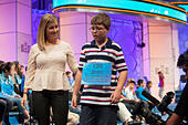 """National Harbor, USA. 27th May, 2015. Joel Miles, 12, a sixth grader at Eagle Glen Intermediate School in Raymore, Mo., is escorted offstage after misspelling """"seriema"""" and being disqualified in round three - one of the preliminary rounds - of the 2015 Scripps National Spelling Bee being held at the Gaylord National Resort and Conference Center on May 27, 2015 in National Harbor, Md. © Allison Shelley/McClatchy DC/TNS/Alamy Live News - Stock Image - ER6N6R"""