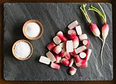 Fresh radishes with salt - Stock Image - C6DYM9