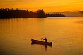 Fishing at sunrise, Boundary Waters Canoe Area lake, border of Minnesota and Ontario, Canada, USA, - Stock Image - BH9P3M
