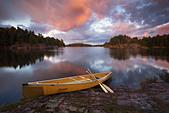 Canoe by granite islands of Georgian Bay, Killarney Provincial Park, Ontario - Stock Image - CFCAP7