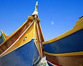 MT - MALTA: Typical Maltese Boats at Marsaxlokk Harbour - Stock Image - A0MG44