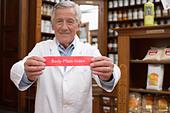 Pharmacist holding body mass index sign - Stock Image - AYTGWK