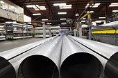 Metal pipes in factory - Stock Image - C1GTT2
