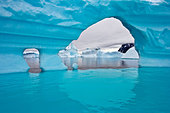 Arched Iceberg in Iceberg Graveyard, Antarctica - Stock Image - D0JN7A