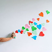 heart,hand,spraying - Stock Image - CWHFNP