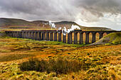 Ribblehead Viaduct, North Yorkshire, UK. 18th October, 2014. The Thames-Clyde Express, hauled by The Duchess of Sutherland locomotive, crosses the famous viaduct in the Yorkshire Dales National Park - Stock Image - E93D8E