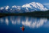 Woman Canoeing in Wonder Lake Denali NP Alaska - Stock Image - AR0NCT