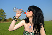 Young Women Drinking Water. - Stock Image - CCB8F3