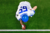 Overhead photo of an American football player center offense about to snap the ball. - Stock Image - C8N1FJ