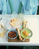 Snacks, bread and cheese for office lunch - Stock Image - AF5K6M