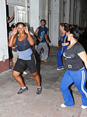 Cuban teenagers, youth, dancing on the street night time. Cienfuegos, Cuba, November 2010 - Stock Image - CWJYA0