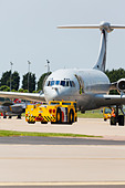 RAF Vickers VC10 of 101 Squadron on the pan with tug at RAF Waddington. - Stock Image - DAB6FE