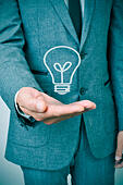 a man wearing a suit with a lightbulb drawn in his hand - Stock Image - EBWWE4