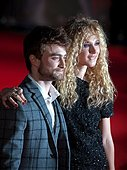 epa04455366 British actor Daniel Radcliffe (L) and actress Juno Temple (R) arrive for the premiere of 'Horns' at Leicester Square, in London, Britain, 20 October 2014. The film will be released across Britain on 31 October.  EPA/WILL OLIVER - Stock Image - E9B8Y1