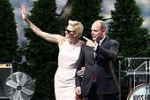 epa04842693 Prince Albert II of Monaco (R) and his wife, Princess Charlene of Monaco look at their twin babies on a balcony during the celebrations to mark Prince Albert II's decade on the throne at the Royal Palace in Monaco, 11 July 2015.  EPA/VALERY HACHE / POOL - Stock Image - EXJH71
