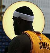 Independence, Ohio, USA. 26th Sep, 2014. The Cleveland Cavaliers' LeBron James is framed by a photographer's light while having his picture taken during the team's Media Day at the Cleveland Clinic Courts on Friday, Sept. 26, 2014, in Independence, Ohio. © Ed Suba Jr./Akron Beacon Journal/MCT/Alamy Live News - Stock Image - E7YRJD