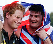 London, UK. 11th Sep, 2014. Invictus Games, day 1. Athletics from Lee Valley Athletics Centre. Prince Harry shares a joke with British team captain David Henson © Action Plus Sports/Alamy Live News - Stock Image - E7APFJ