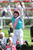 Ascot, Berkshire, UK. 18th June, 2015. Frankie Dettori executes a 'flying dismount' after his Royal Ascot win on Time Test in the Tercentenary Sks 18 June 2015 © John Beasley/Alamy Live News - Stock Image - EW6CF4