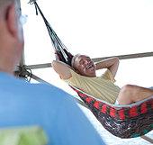 Caucasian man laying in hammock - Stock Image - C3RMHN