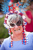 A woman dressed in patriotic costume stands in the I'On Community 4th of July parade. - Stock Image - C5M41P