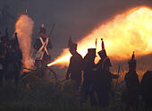 """Waterloo, Belgium. 20th June, 2015. Re-enactors fire cannon on the battlefield during the re-enactment of the """"The Allied Counterattack"""" battle as part of the bicentennial celebrations for the Battle of Waterloo, in Waterloo, Belgium June 20, 2015. © Zhou Lei/Xinhua/Alamy Live News - Stock Image - EW9M08"""