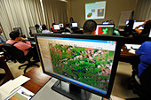 Forest managers are being trained how to read satellite images, monitoring system to monitor the deforestation of the Amazon - Stock Image - CXYH2W