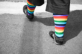 A woman wears rainbow socks in celebration of Gay Pride. - Stock Image - C60BM1
