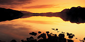A romantic sunset nr Oban Scotland UK - Stock Image - AA17FE