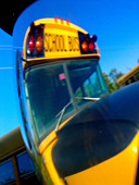 Yellow School Bus from Distorted Angle on a Bright Sunny Day - Stock Image - A90X9D